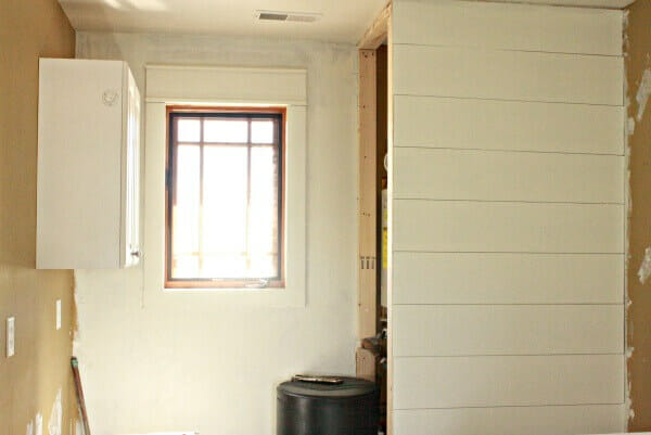 One Room Challenge Laundry Room Remodel Week 3 is here! Come see how we started shiplap walls!   Twelveonmain.com