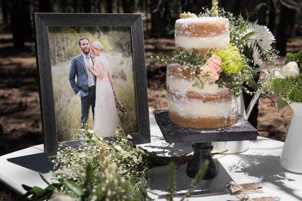 Simple and elegant wedding cake for an outdoor woodland themed wedding. Love the blush colored flowers and babies breath. The raw look of the cake is so cool!