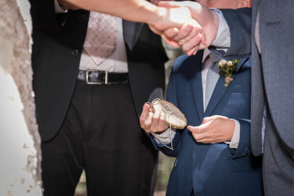A wood round used to tie wedding rings for an outdoor woodland wedding.