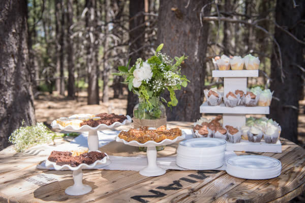 This outdoor woodland themed wedding was perfect. They displayed their desserts on an old wire spool. The rustic wood with the delicate ceramic serve ware is perfect.