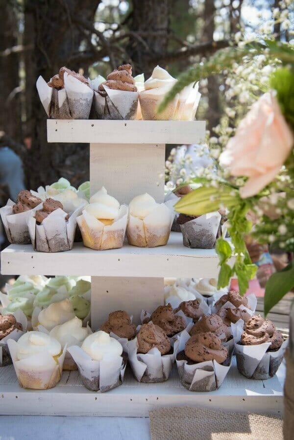These neutral tones cupcakes were served at an outdoor woodland wedding. Love that handmade cupcake stand and the parchment cupcake wrappers.