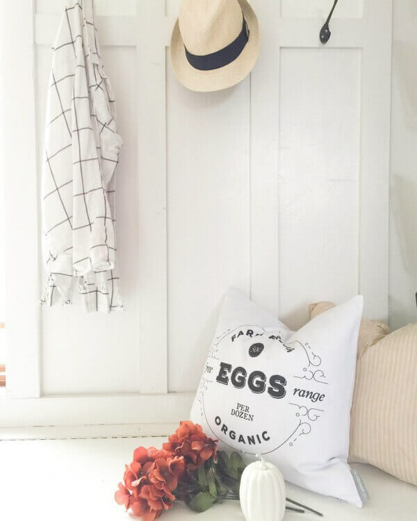 a-mudroom-decorated-for-fall