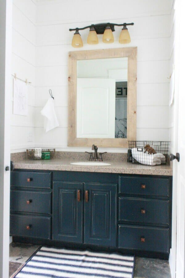 Simple farmhouse touches took this budget friendly bathroom makeover to another level!