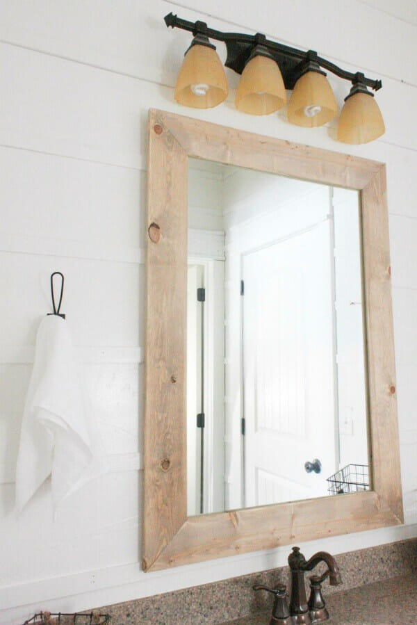 A simple farmhouse hook is the perfect addition in this budget friendly bathroom makeover. Did I mention it was done for under $100 dollars?