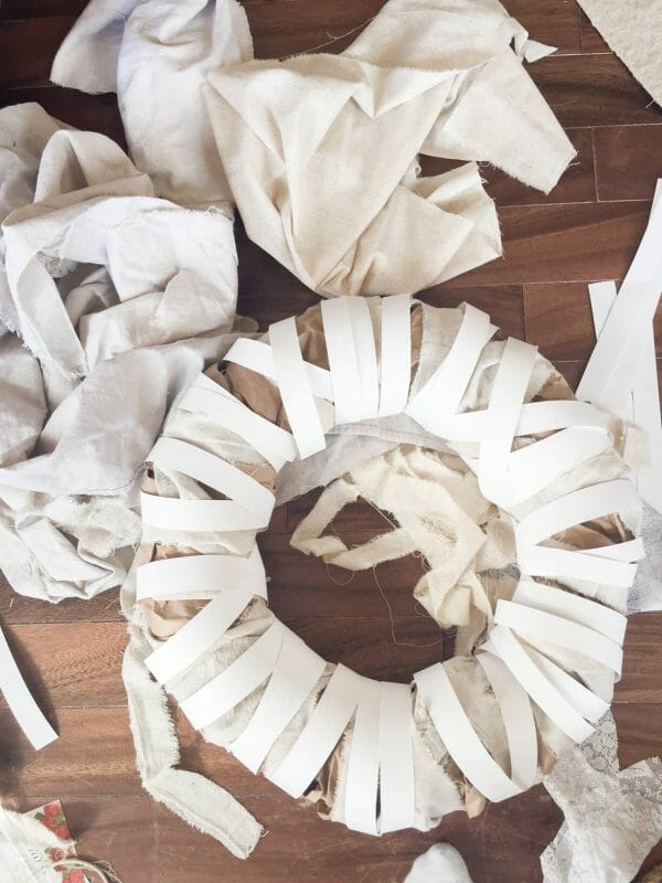 Use standard white poster board to create an awesome DIy farmhouse wreath