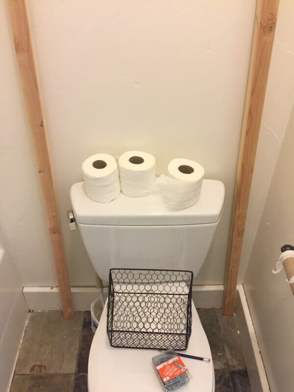 Make this DIY over the toilet towel storage ladder!