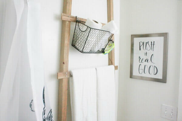 This simple over the toilet towel storage ladder is so easy to make and will look great in your bathroom!