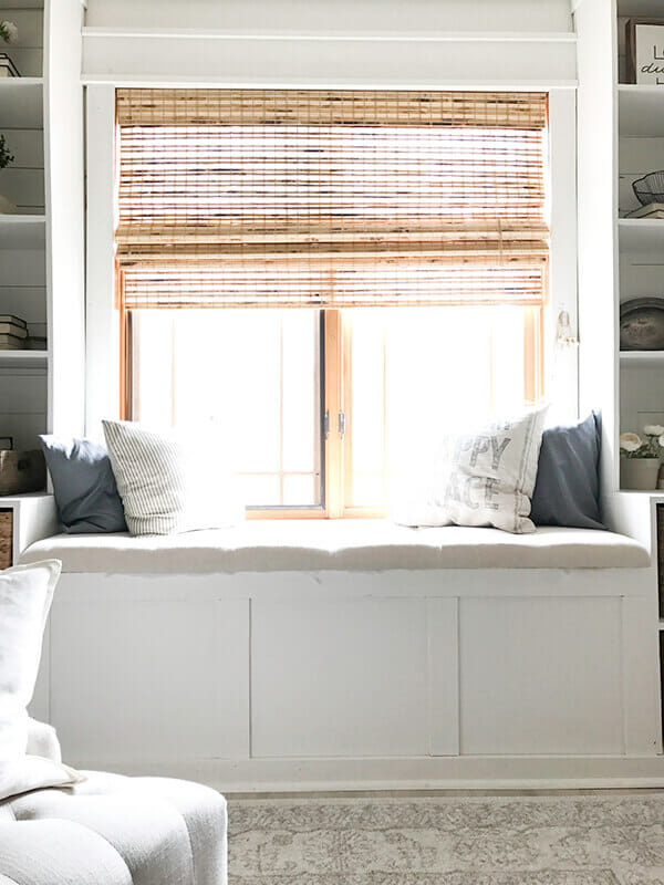 Some of my favorite farmhouse bedroom features include a cozy fireplace, a comforting window seat, faux beams, farmhouse style lighting, and so much more!