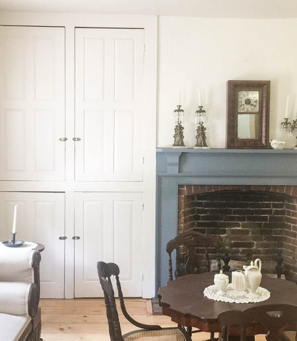 Primitive style farmhouse fireplace and mantle