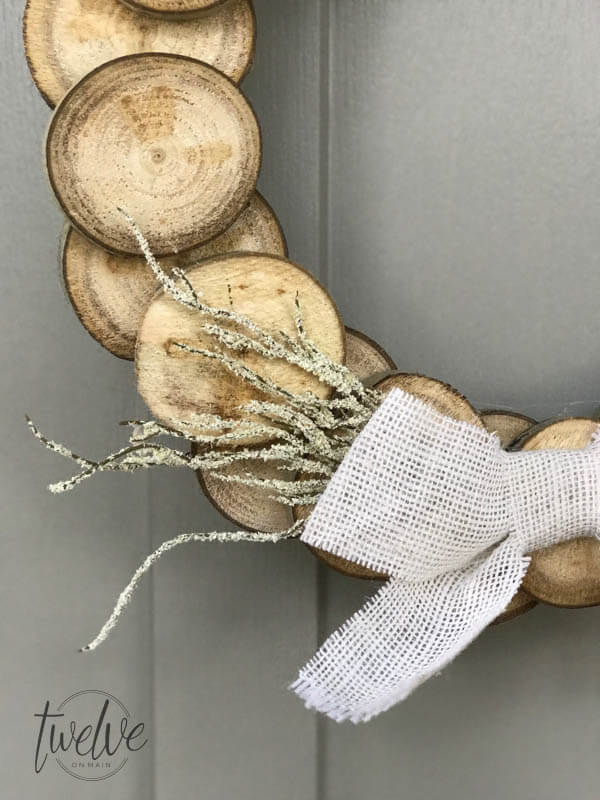 I love using wood slices for home decor.  CHeck out this fall wreath made with them!