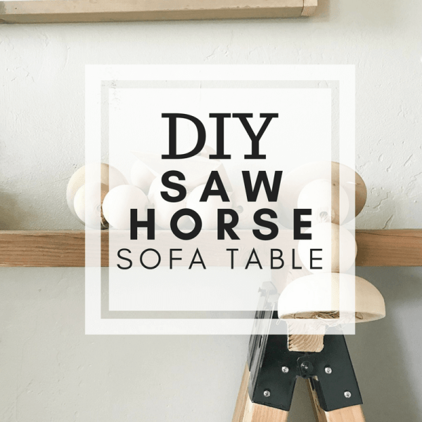 Want a really easy DIY project? Make this super easy DIY sawhorse sofa table for under 30 dollars! It looks so great in any style home!