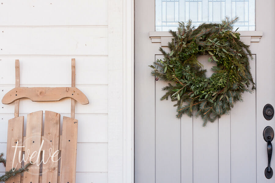 Fresh blue spruce trees, simple natural farmhouse Christmas decor, are all you need to create a beautiful farmhouse Christmas porch and entry.