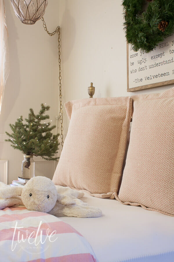 Girls bedroom decorate for Christmas with pink and green decor. A small Christmas tree and a simple holiday wreath is all you need!