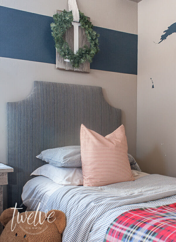 Want to decorate your bedroom for Christmas but don't know where to start? You only need a few inexpensive items to create the most cozy Christmas bedroom! Cozy boys bedroom decorated with farmhouse Christmas decor!