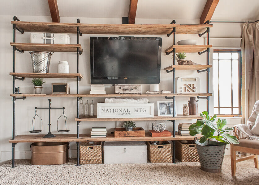 Industrial style shelves combined with farmhouse style living room accents create a cozy space to relax.