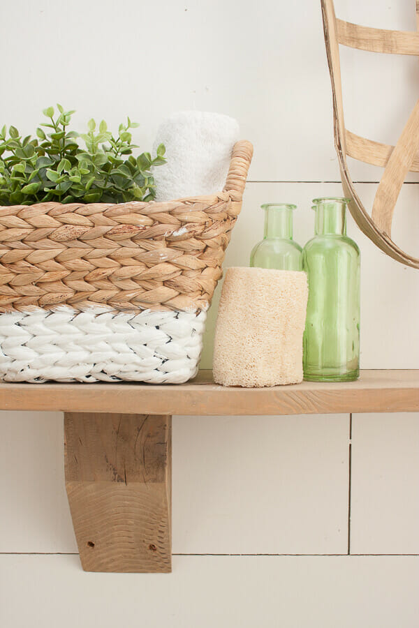 Making easy rustic wood shelves is easier than you think! Read on to see how I added farmhouse rustic charm to my bathroom for mere pennies!