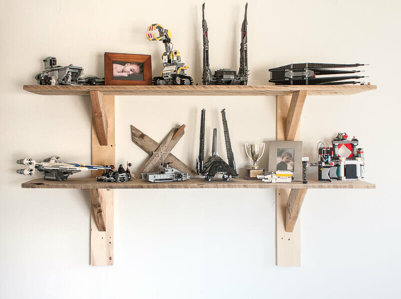 Rustic shelves in a kids bedroom displaying Lego collections!