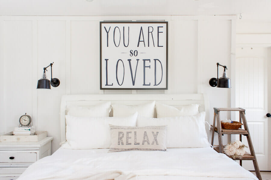 Simple farmhouse style master bedroom with white linen bedding! Come see how easy it is to keep your bed pillows looking like new!