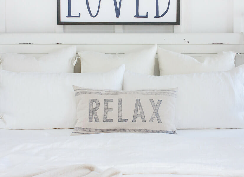 I love this bed and those bed pillows dressed in white linen bedding!