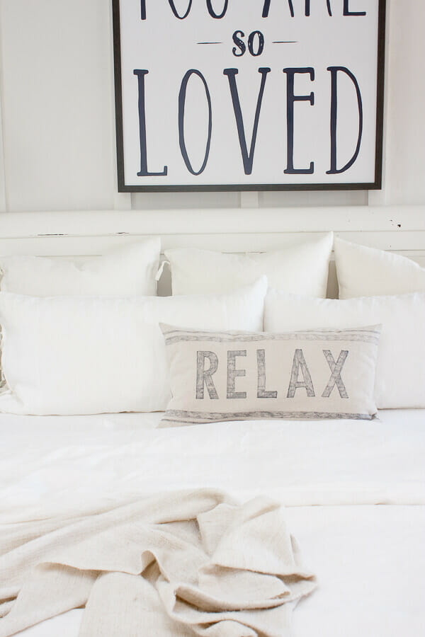 Farmhouse style white linen bedding from IKEA and the best way to keep your bed pillows looking like new!