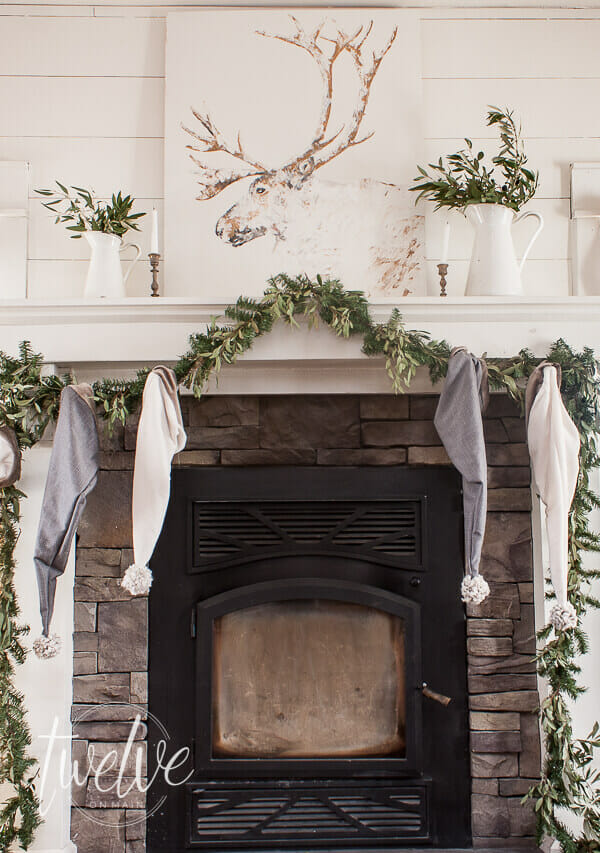 Winter caribou painting above the mantel. Love this farmhouse artwork for the winter