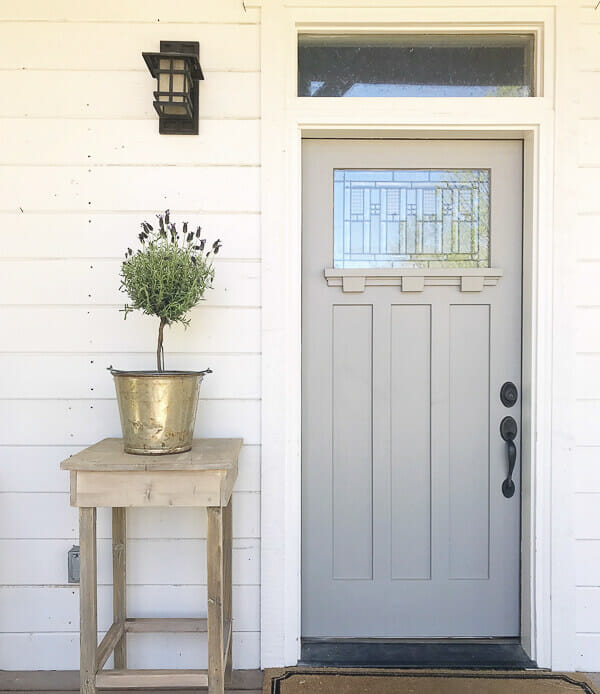 Love how this outdoor side table looks with this front door. Its a beautiful combination. Make on for yourself here!