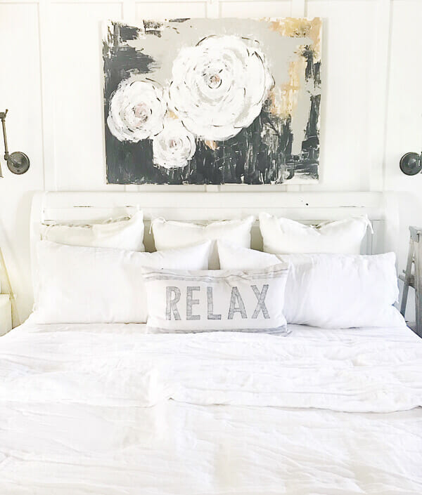 Farmhouse artwork in the bedroom. Beautiful abstract floral painting!