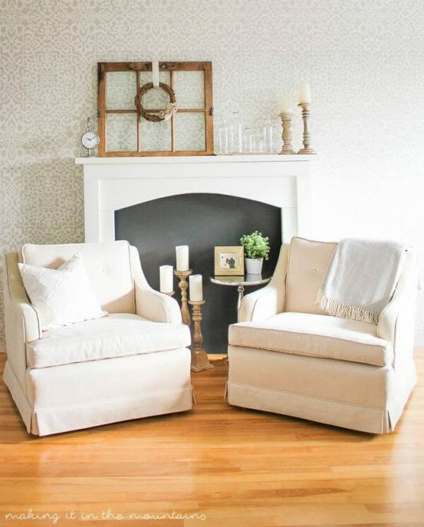 Farmhouse style DIY faux fireplace with simple features and a black insert
