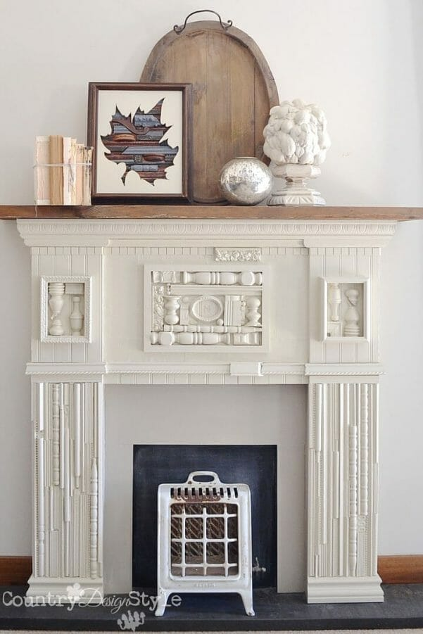 Incredible DIY faux fireplace with scrap wood accents. SO pretty!