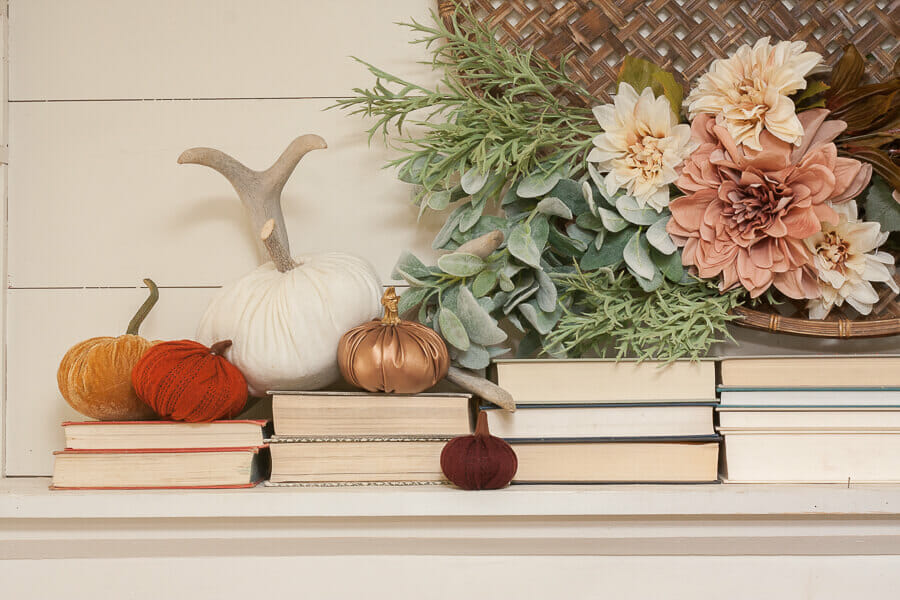 Gosh I love the blush and orange colors of these pumpkins! They look so perfect with the flowers and books on this mantel!