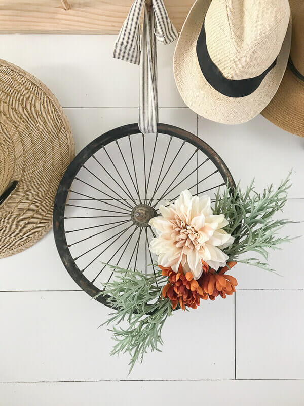 What a super cute and stylish upcycled bicycle wheel wreath
