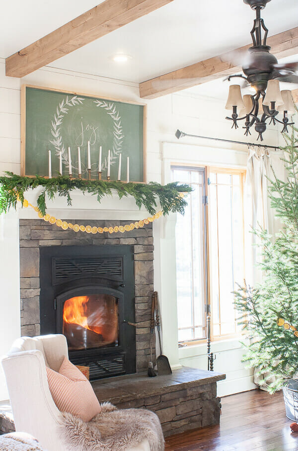 Are you a fan of the popular Scandinavian Christmas decor? Well, come check out my Scandinavian inspired Christmas mantel and tips to do it yourself!