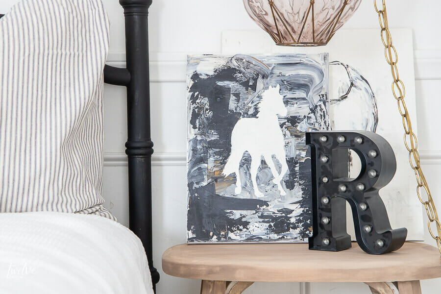 A touch of whimsey and radical with this modern style horse art in my daughters bedroom .