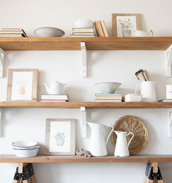 Gorgeous styled shelves full of modern farmhouse decor and adorable watercolor spring printables that are available for FREE here!