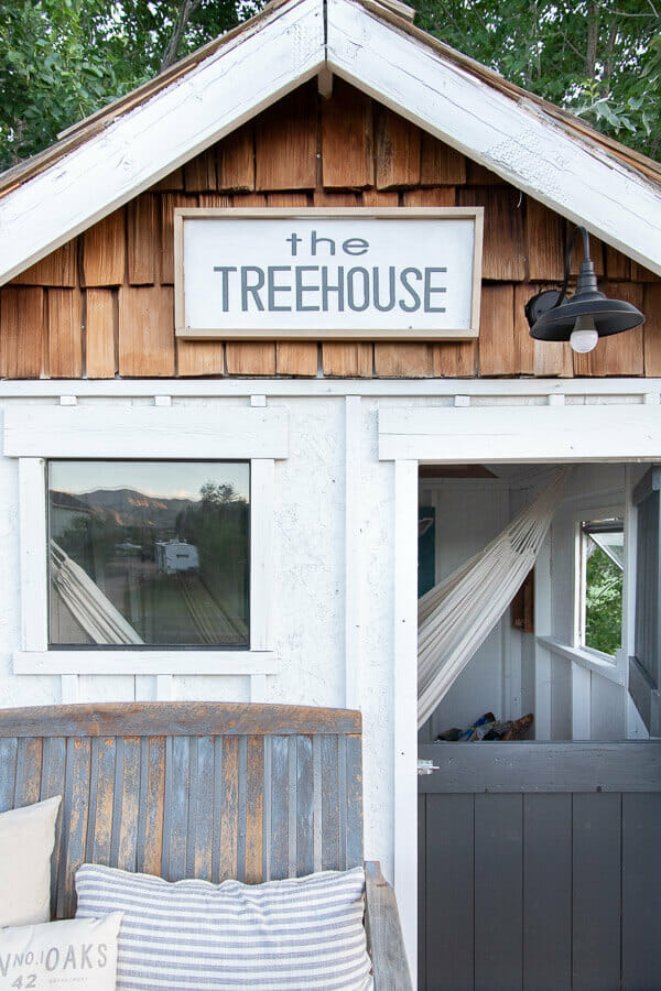 Get inspired with this amazing treehouse design! Love the hammocks and the front porch!