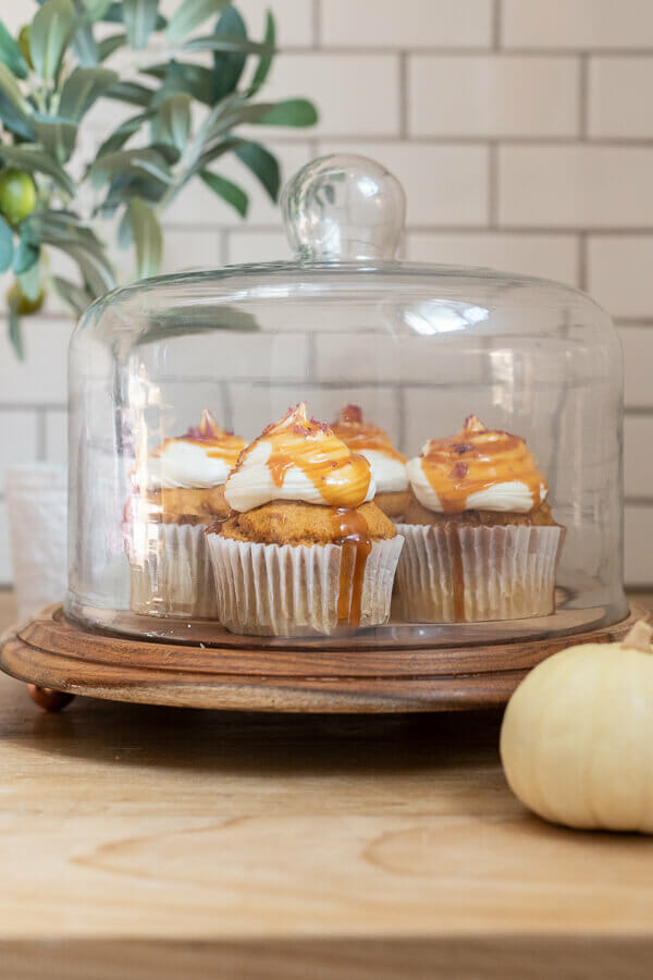 The easiest pumpkin cupcake recipe with cream cheese icing, caramel sauce drizzle and topped with a pinch of sea salt! This cupcake is perfect for fall!