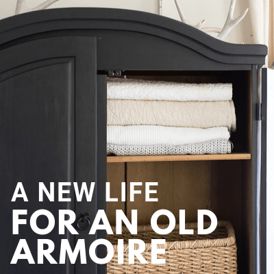 Black armoire in the living room. Stylish and functional, creating storage that is sorely needed. How I took an unloved cheap piece of broken furniture and transformed it.