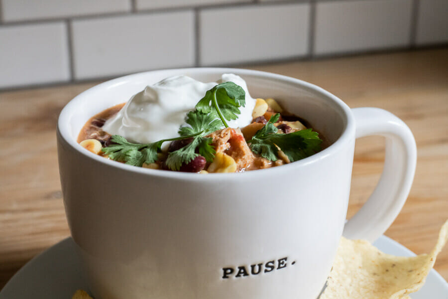 Make this easy crock pot white chicken chili recipe now! Its the perfect meal on a cold fall day. Warm yourself with the spicy flavor and enjoy the creaminess of the chili with the tender chicken that has been cooked all day! Make your dinner easy by making this slow cooker white chicken chili!