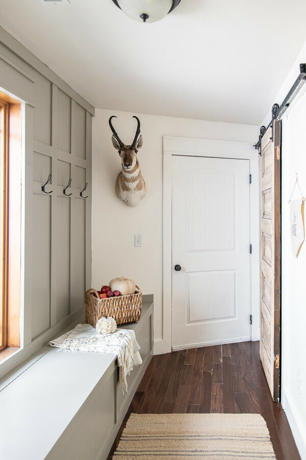 Farmhouse fall mudroom decor. Simple neutral, and striking.