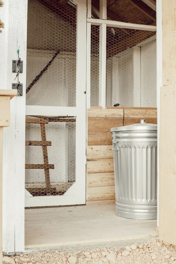Chicken coop design ideas complete with dutch doors, nesting box ideas, a covered chicken run and gorgeous solar lights!
