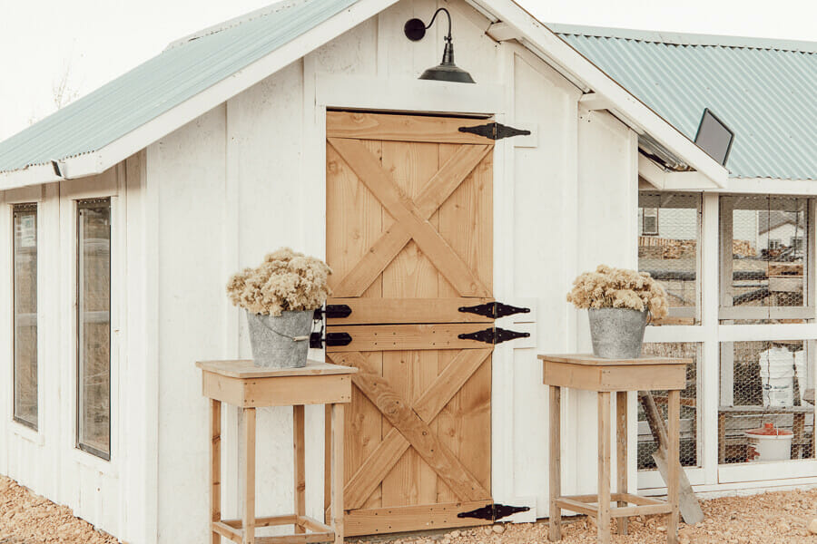 Gorgeous chicken coop ideas including dutch doors, stylish solar outdoor lights, and so much more!
