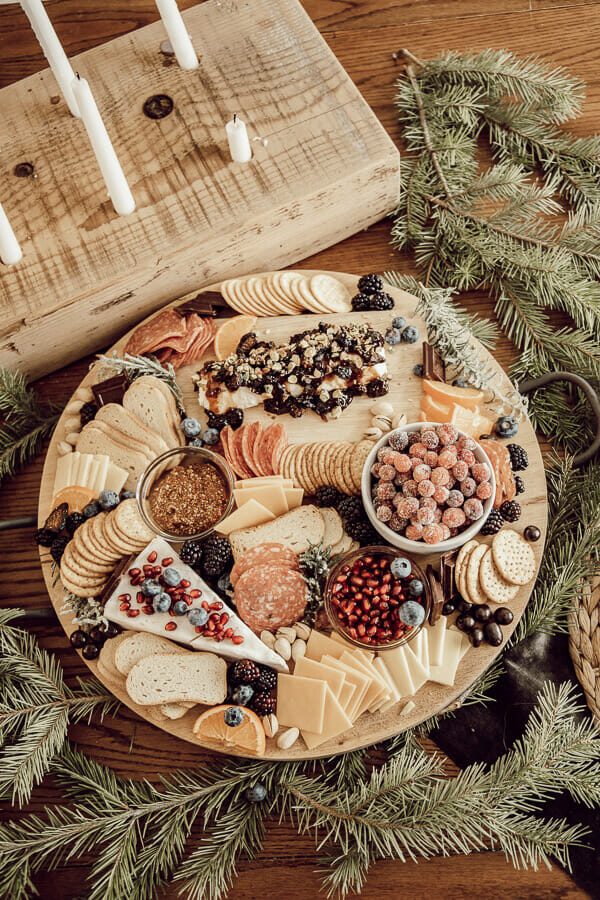 How to make a gorgeous holiday charcuterie board that is delicious and full of texture and style. Take a simple meat and cheese plate and turn it on its head!