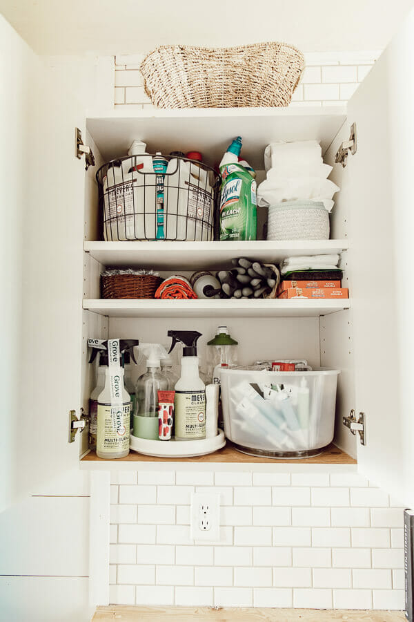 How to clean and organize a cleaning cabinet like a boss. Add all natural safe cleaners to your routine as well! I have all the details and tips!