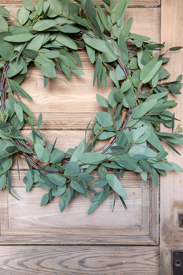 Make this gorgeous faux eucalyptus wreath using only 3 items and make it in less than 10 minutes.