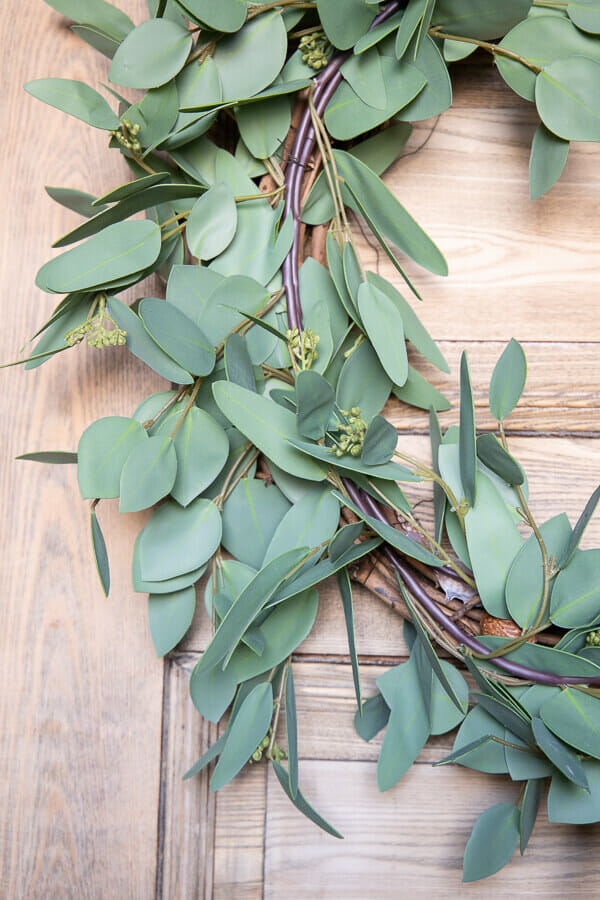 Make this gorgeous faux eucalyptus wreath for spring, summer or all year long. This wreath takes less than 10 minutes to make and looks amazing! The best part is you can disassemble and change it out for different seasons. It is a great budget friendly way to have gorgeous wreaths in your home! 10 minutes.