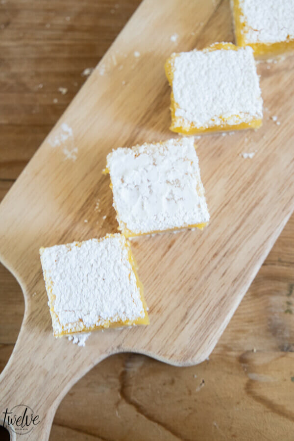 Sweet, tangy and gooey lemon bars. These are the most amazing lemons bars I have ever had! With a thick layer of lemon in the middle atop a tender crust and topped with powdered sugar, this treat is a hit! Eat them fresh, out of the fridge, or (our favorite) frozen!
