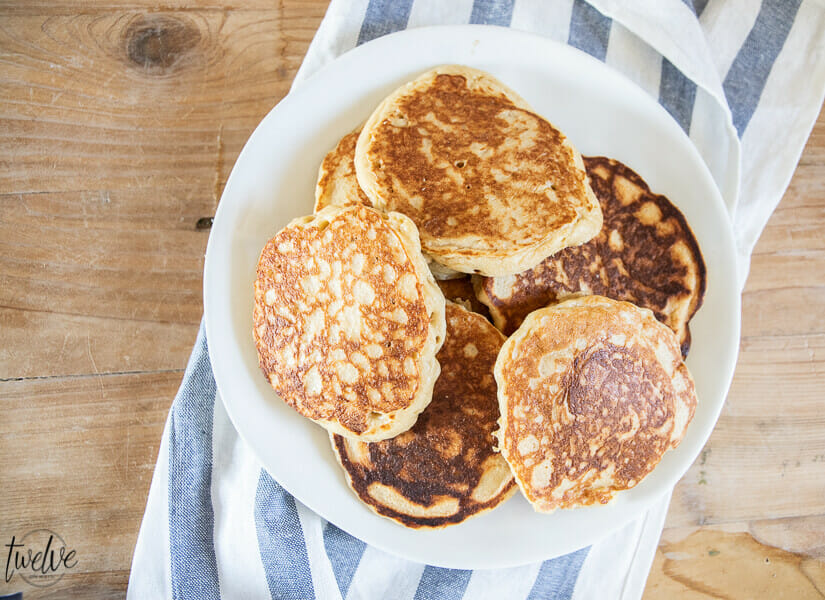 How to make amazing light and fluffy whole wheat pancakes using your blender! These pancakes are so flavorful and have a sweet nutty flavor and just plain amazing!