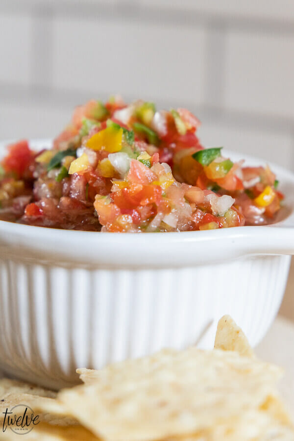 Get this zesty fresh salsa recipe now!  Makes the most amazing nachos, perfect on eggs and breakfast burritos, and killer on tacos.  Make it now!