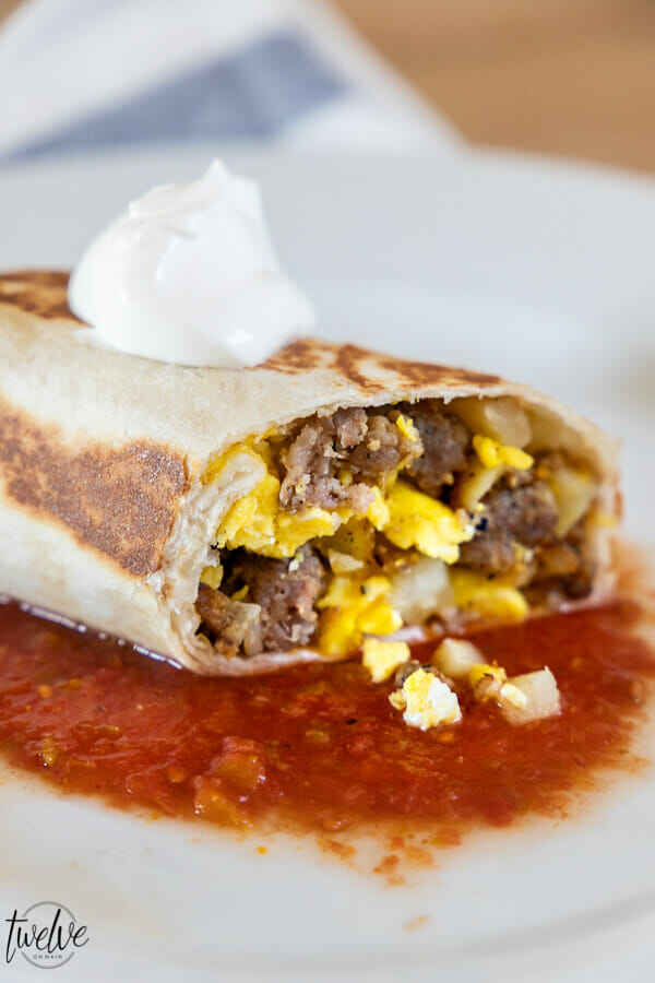 Super easy and super tasty egg, sausage, and potatoe breakfast burrito recipe.  This is one of our favorites, makes enough for leftovers and is a hit!