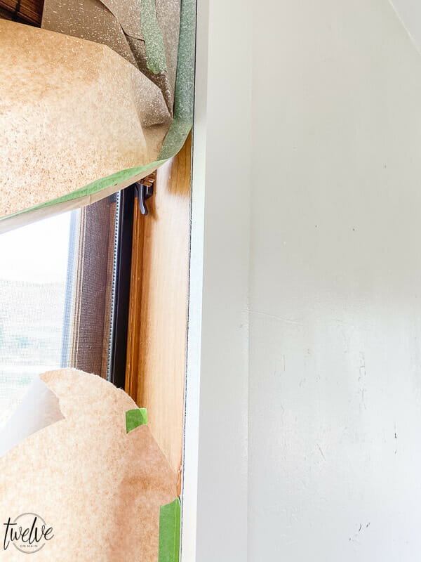 How to paint around windows using a paint sprayer.